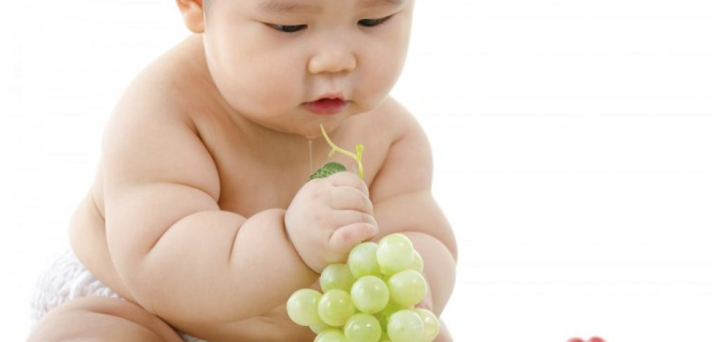 Baby with grapes