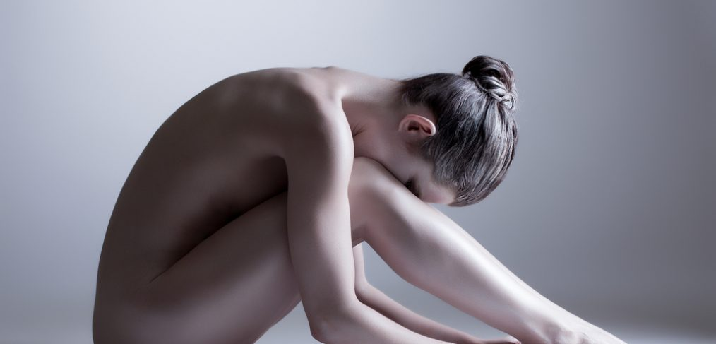 Nude model reflecting on body image