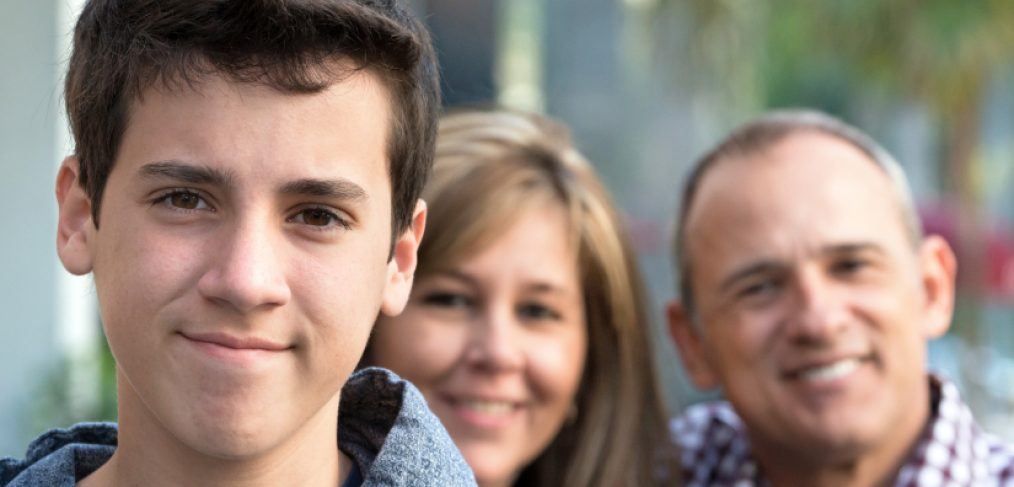 Teenage boy with parents