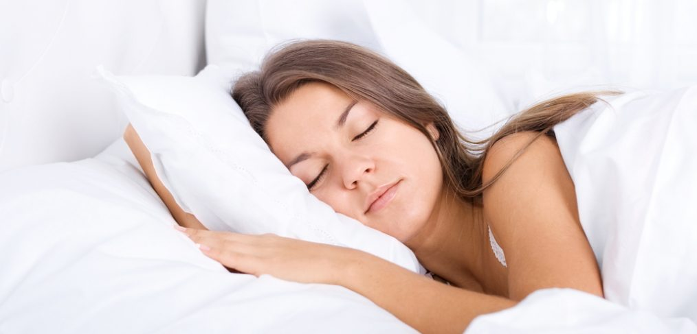 Beautiful woman sleeping peacefully on a pillow