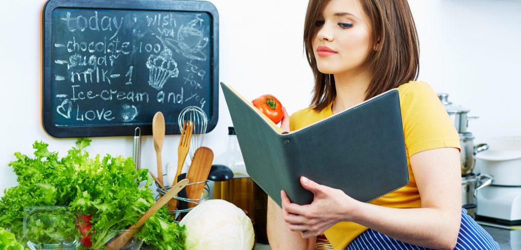 Woman trying to decide what to make for dinner.