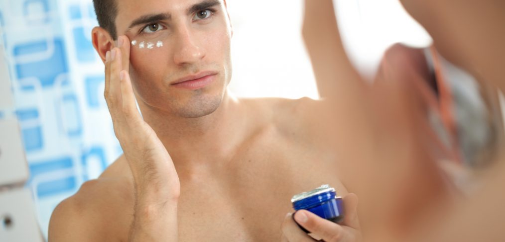 Man applying anti-aging cream.
