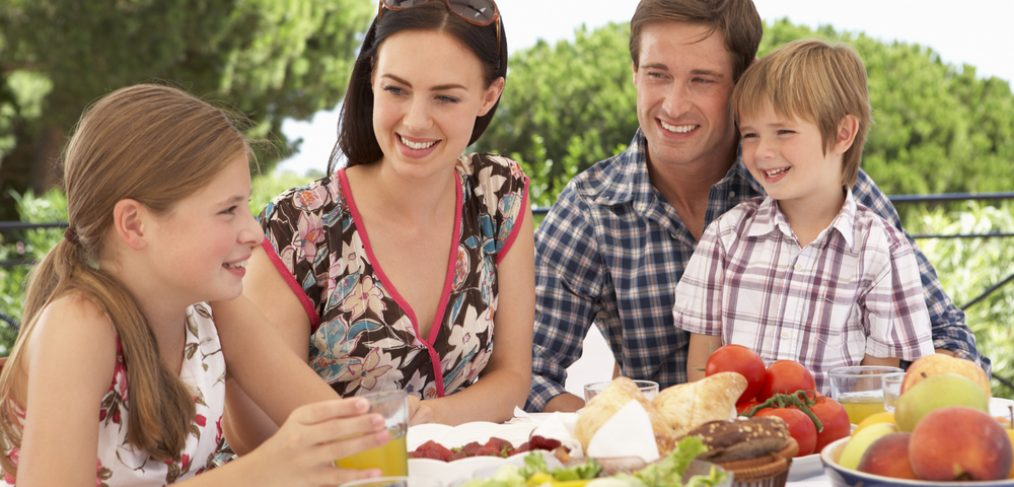 Family enjoying an outdoor picnic