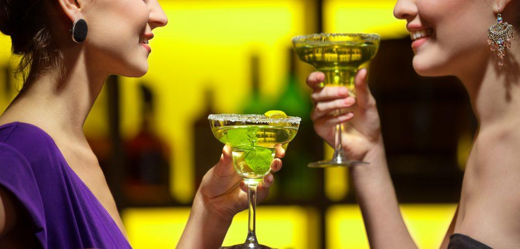 Two women enjoying martinis