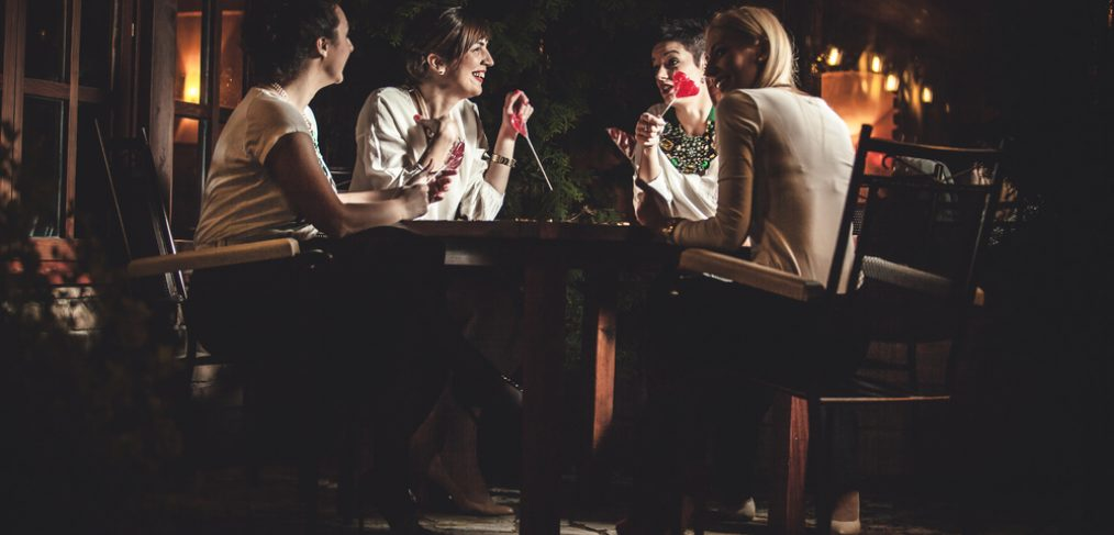 Friends having dinner in restaurant
