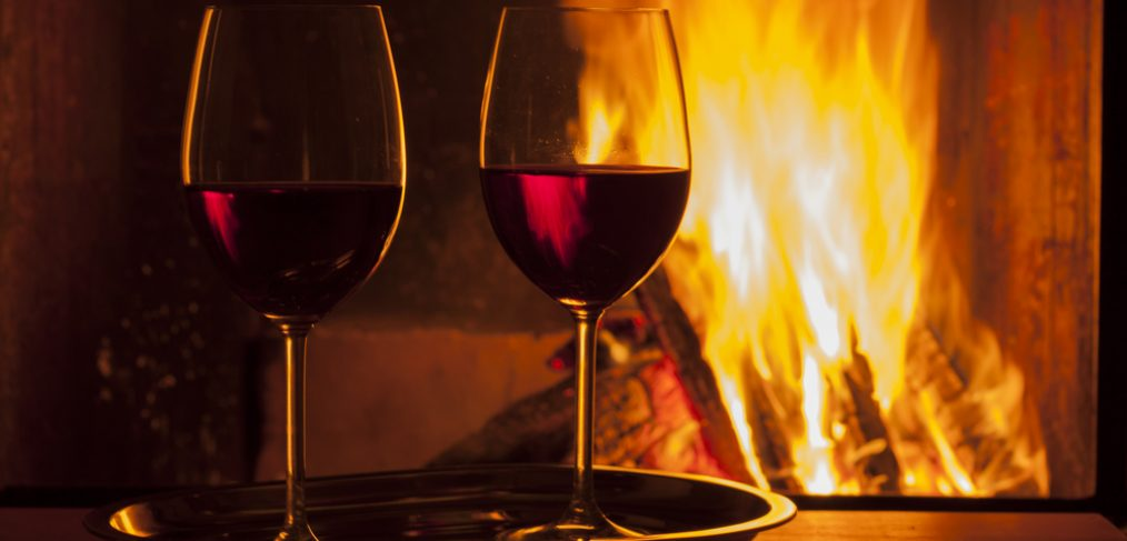 Red wine by the fireplace.