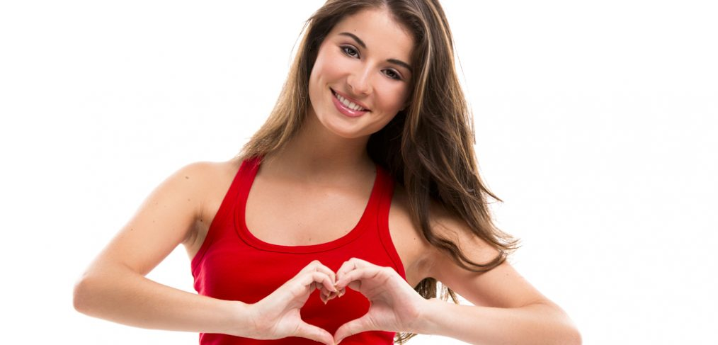 Woman showing a healthy heart