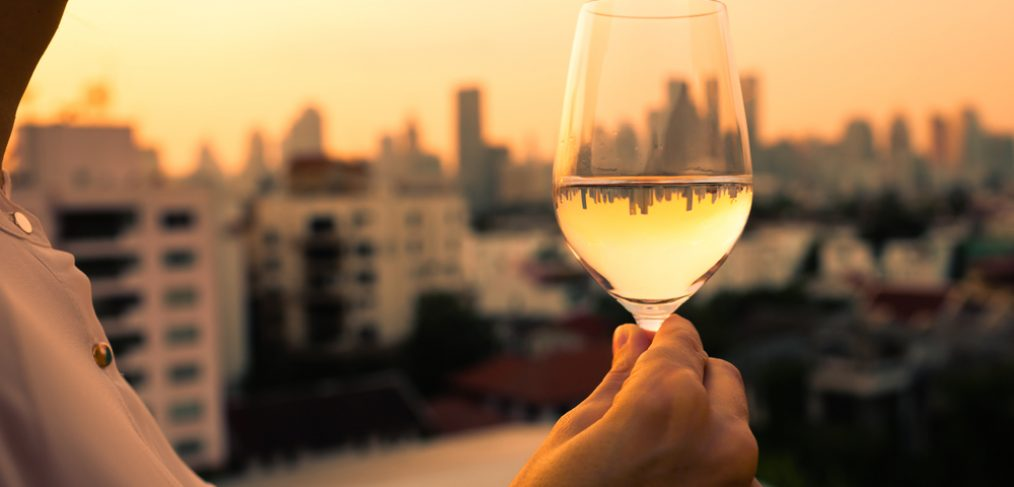 Woman having wine at sunset