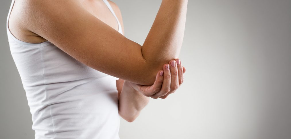 Woman having elbow pain