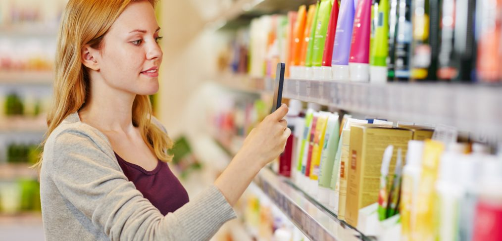 Woman buying cosmetics from a store