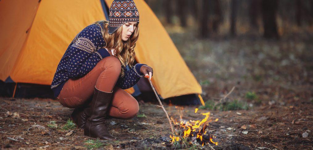 Woman lighting up a fire