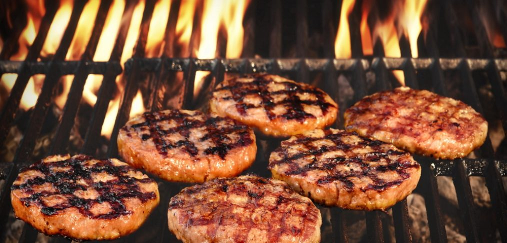 Grilled Burgers Patties On The Hot Flaming Charcoal Grill