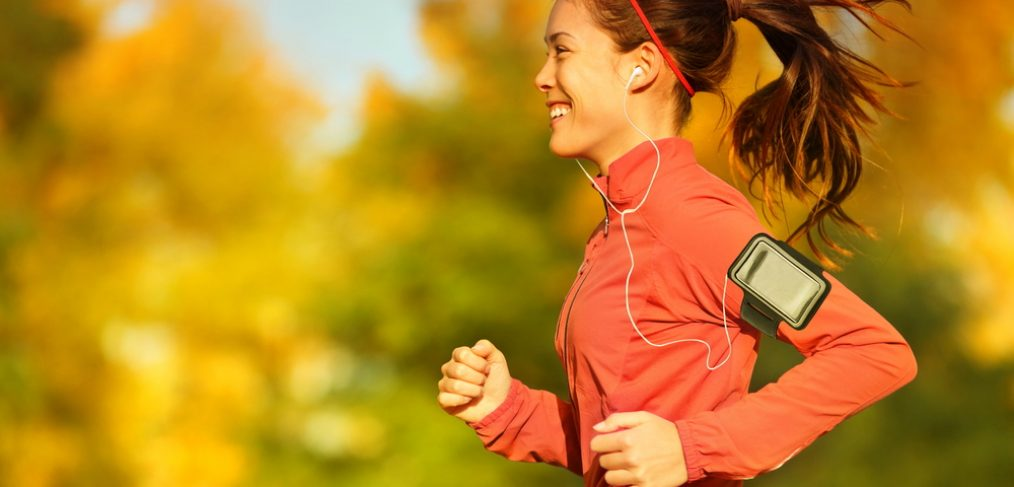 Woman running outdoors during fall season