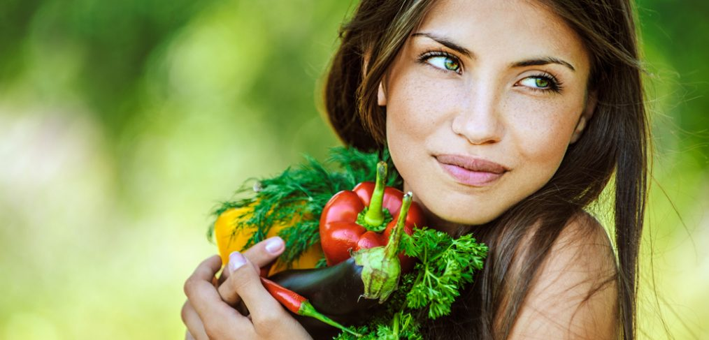 Woman holding organic foods