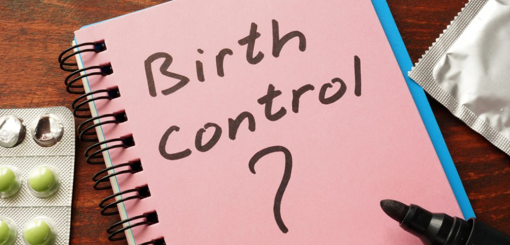 Notebook with the word birth control written on it.