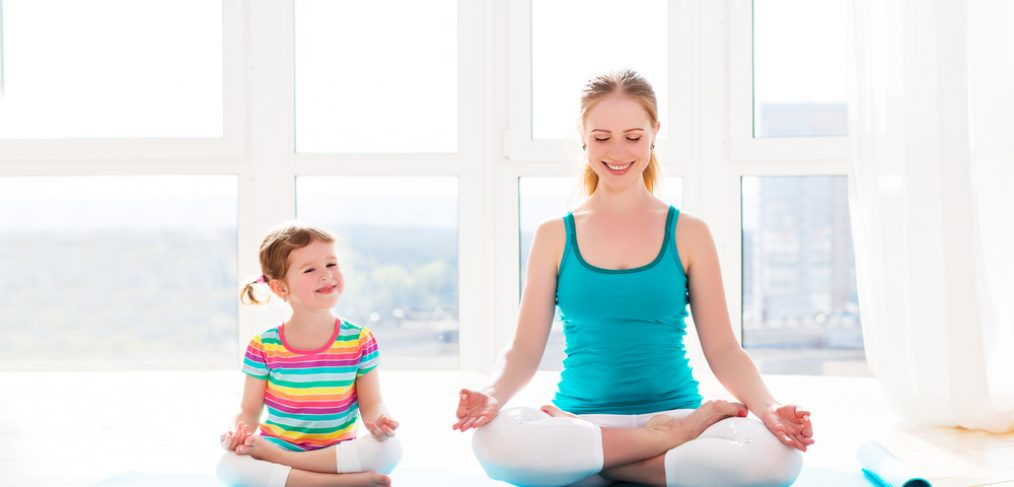 Mother and child doing yoga pose