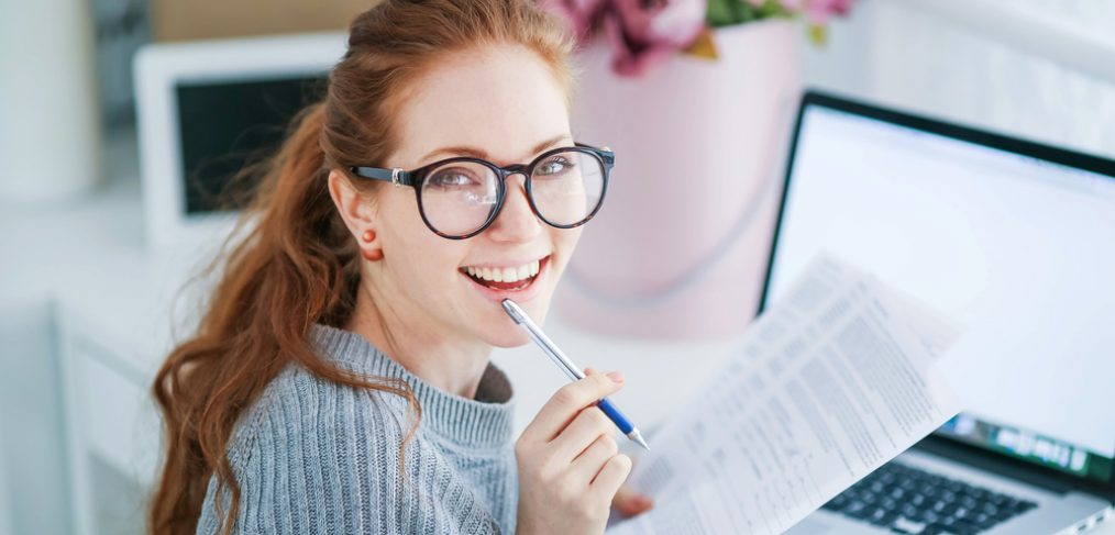 Smiling woman working at desk