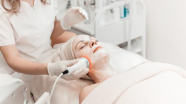 Woman enjoying facial treatment