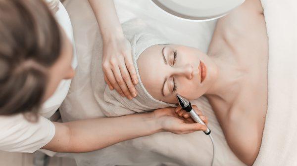 Woman undergoing facial spa treatment