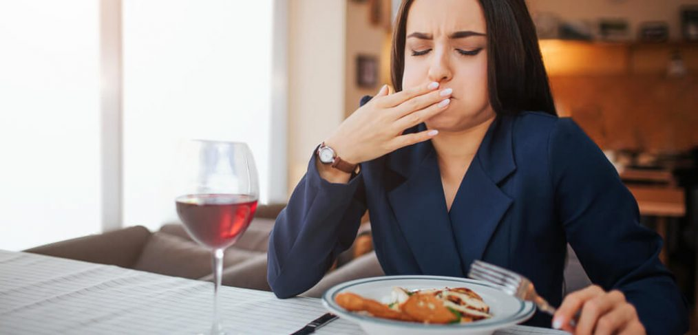 Woman feels sick while eating lunch